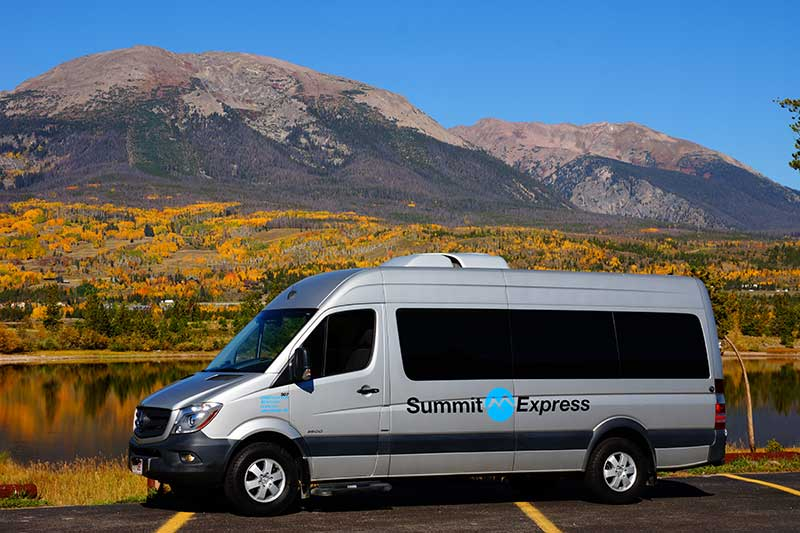 summit express sprinter van by lake dillon in fall
